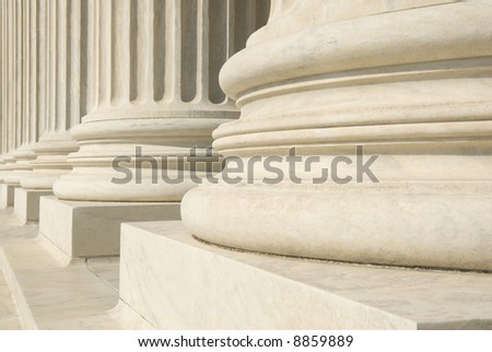 A row of columns at the entrance to the US Supreme Court in Washington, DC. #8859889