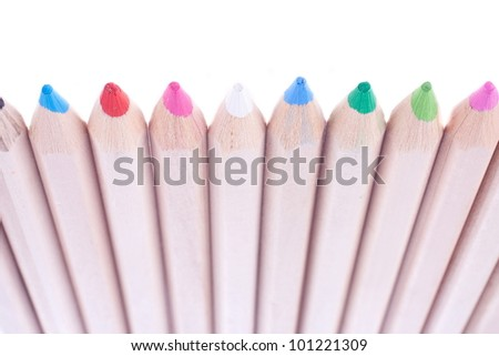 a row of crayons under the white background