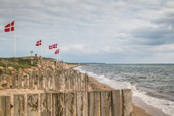 A Row of danish Flags on the Beach