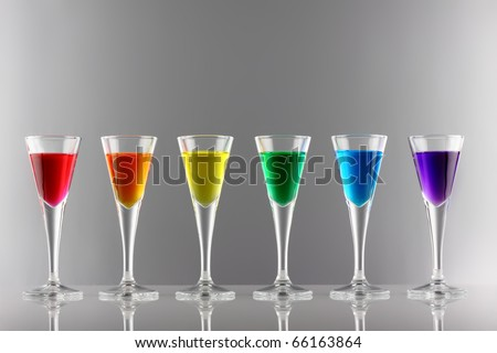 A row of drinks in rainbow colours