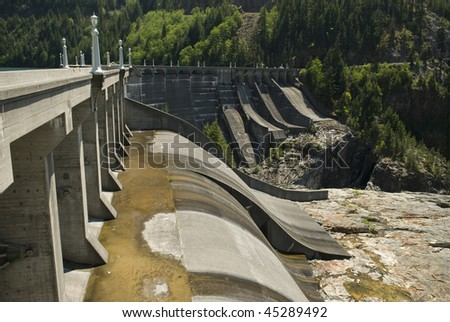 a row of dry spillway gates downstream at a large hydroelectric dam