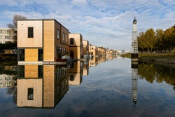 A row of floating homes located in Rotterdam Nassauhaven port. Innovative sustainable living in a city threatend by rising sea levels.