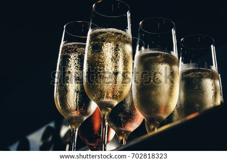a row of glasses filled with champagne are lined up ready to be served #702818323