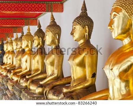a row of golden buddha statue