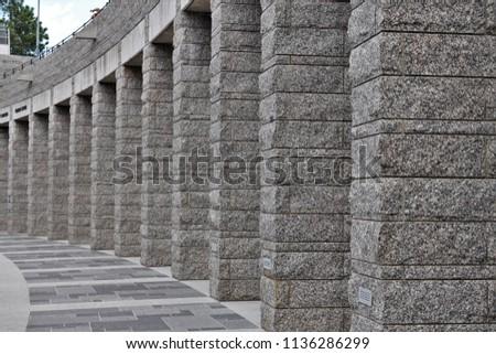 a row of grey granite columns.  ...