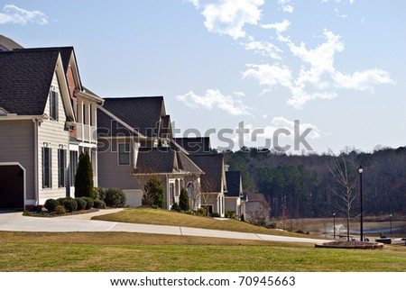 A row of modern houses in a suburban neighborhood.