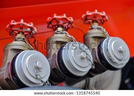 A row of neat fire hose switch interfaces on a red background #1318745540