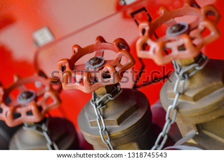 A row of neat fire hose switch interfaces on a red background #1318745543