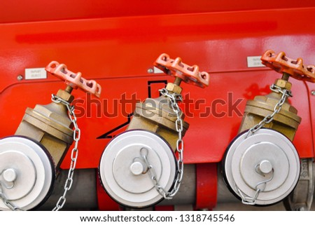 A row of neat fire hose switch interfaces on a red background #1318745546