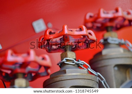 A row of neat fire hose switch interfaces on a red background #1318745549