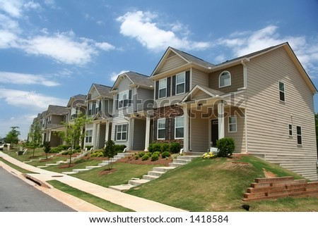 A row of new townhomes or condominiums.