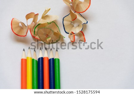 a row of pencils and shaving