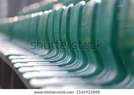 A row of plastic seats in the stadium. Seats in the stadium.  #1566922888
