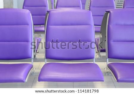 a row of purple chair
