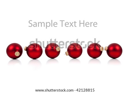 A row of red Christmas ornaments/baubles on a white background with copy space