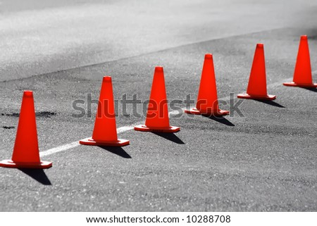 A row of safety cones blocking off a road