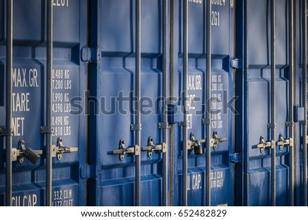 A row of shipping containers, at a self storage unit