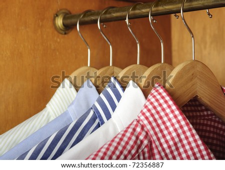 a row of shirts hanging