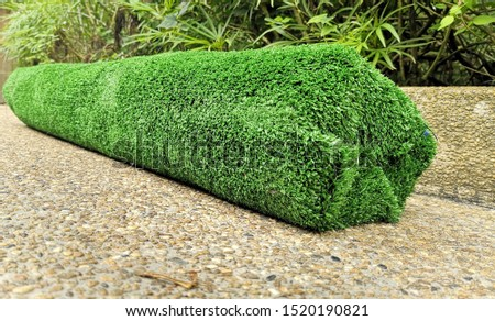 A row of synthetic grass is used as an outdoor landscape design material.  #1520190821