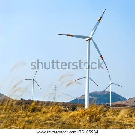 A row of turbines of windmills at Jeju Island of South Korea
