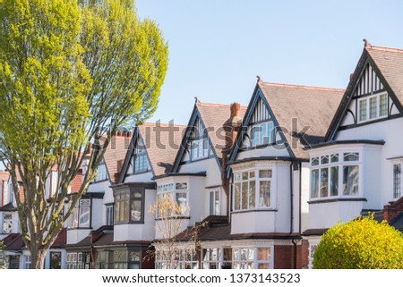A row of typical British suburban houses