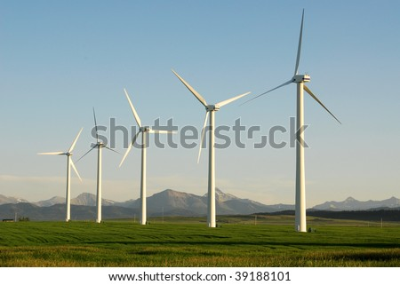 A row of windmills on prairie at pincher creek, alberta, canada. These wind turbines make pincher creek the wind energy capital of canada.