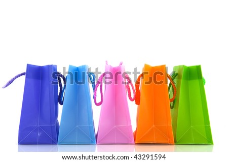 A row with colorful shopping bags with white background