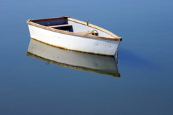 A rowboat and its reflections