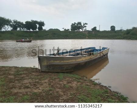 A rowing boat on the shores of Damdama Lake, Gurgaon #1135345217