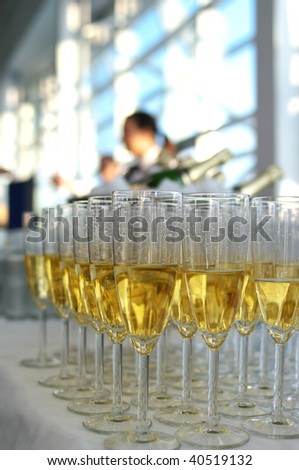 A rows of the wineglasses with champagne in the restaurant