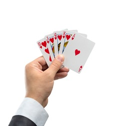 A royal flush in hearts in hand isolated on white background