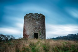 A ruined tower, the remains of Maker windmill near Mount Edgcumbe in Cornwall
