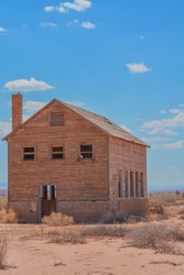 A rundown abandoned wood house in Tuba City Arizona on the Navajo reservation