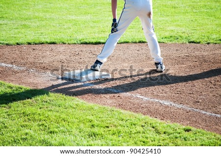 A runner waits on first base for the next hit