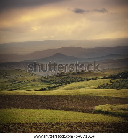 a rural and hilly area in sicilian outback at evening