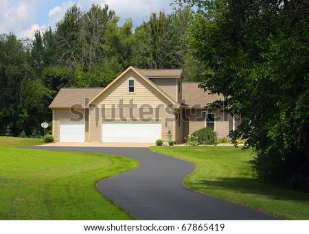 A Rural Home At The End Of A Driveway.