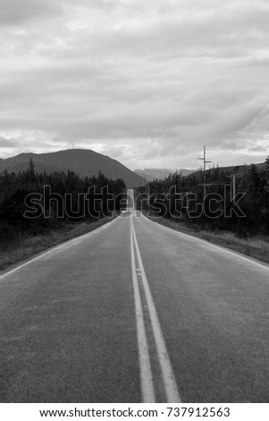 A rural straight road into the horizon with blue cloudy sky/ Road into the Horizon #737912563