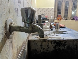 A rust tap in the kitchen of a middle class home of India.