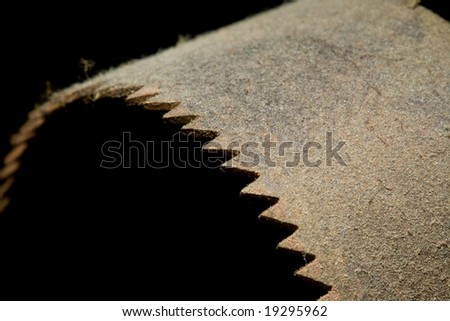 A rusted old saw blade covered in dust - stock photo