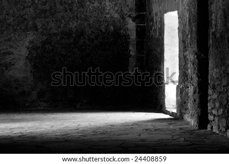 a rustic hall with sunlight spilling through the door.