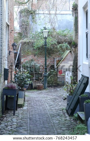 A rustic little alley in the Netherlands #768243457
