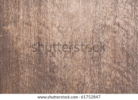 A rustic weathered plywood surface.
