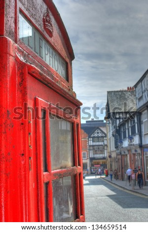 A Rusty British Red Telephone Box in the Summertime in England - stock photo