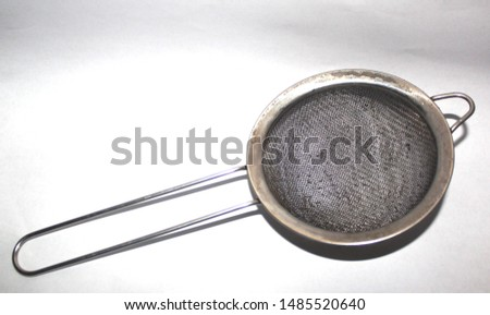 a rusty stainless steel sieve