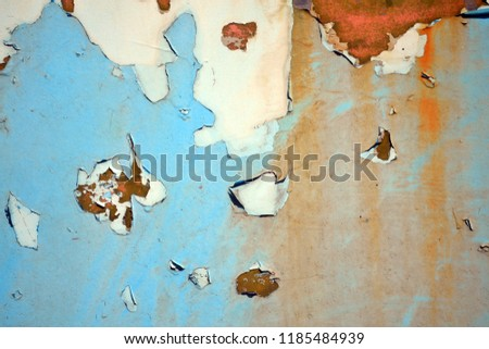 A rusty wall. Blue and white wall of iron. Old rusty metal. Metal background or texture. Rusted texture.