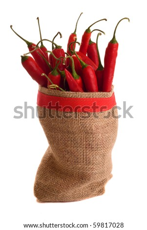 a sac of red chillies isolated on a white background.