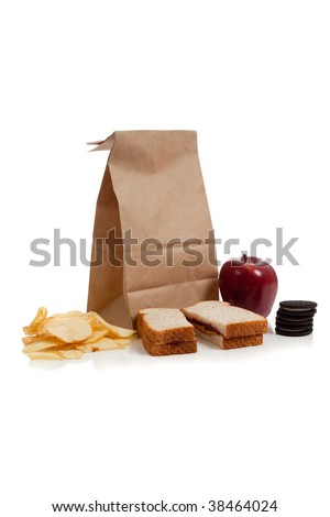 A sack lunch with peanut butter sandwich and a apple