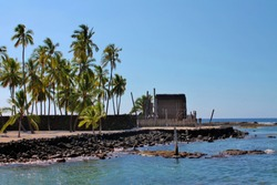 A sacred native warrior cove with a tiki hut in the distance on the Big Island of Hawaii