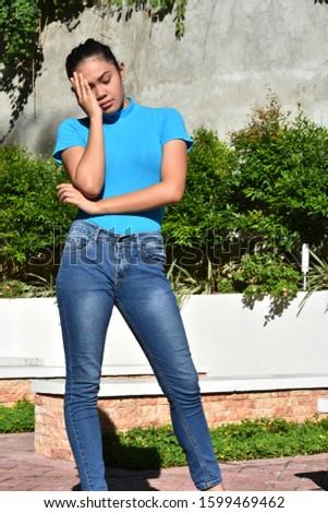 A Sad Attractive Adult Female