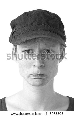 A sad or grumpy woman with a baseball hat over a white background.